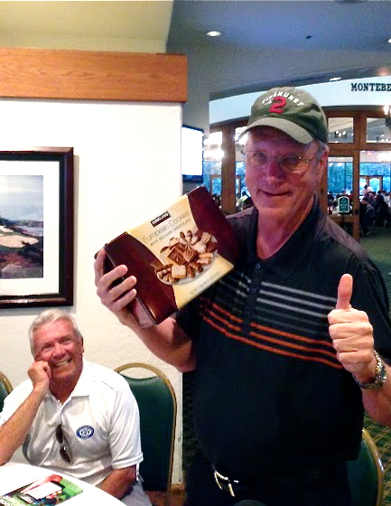 Larry Welborn wins a prize at the Social Golf Course Tournament