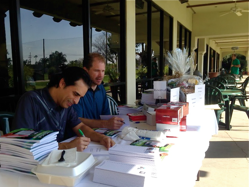 Zeb Welborn and John Hakim Sign Books